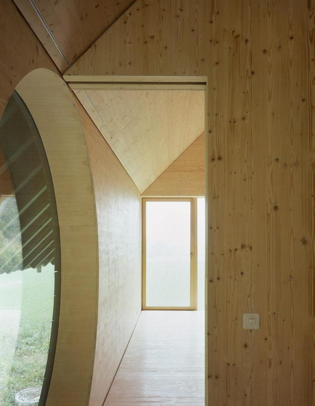 barn-home-floats-round-window-over-lower-facade-glass-22-upstairs.jpg
