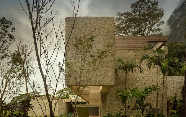 contemporary-hillside-luxury-house-made-from-stone-3-side-view.jpg