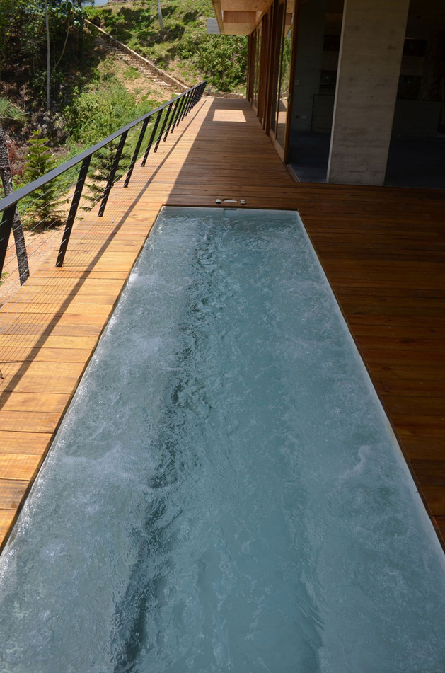 grass-roofed-home-built-slope-hillside-cooling-10-pool.jpg