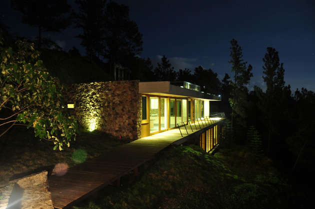 grass-roofed-home-built-slope-hillside-cooling-24-night.jpg