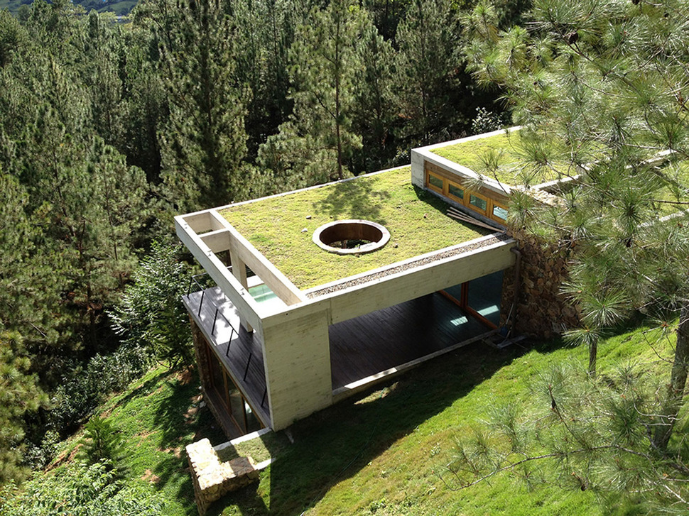 Grass roofed home built into slope uses hillside for cooling for 10180 old well terrace