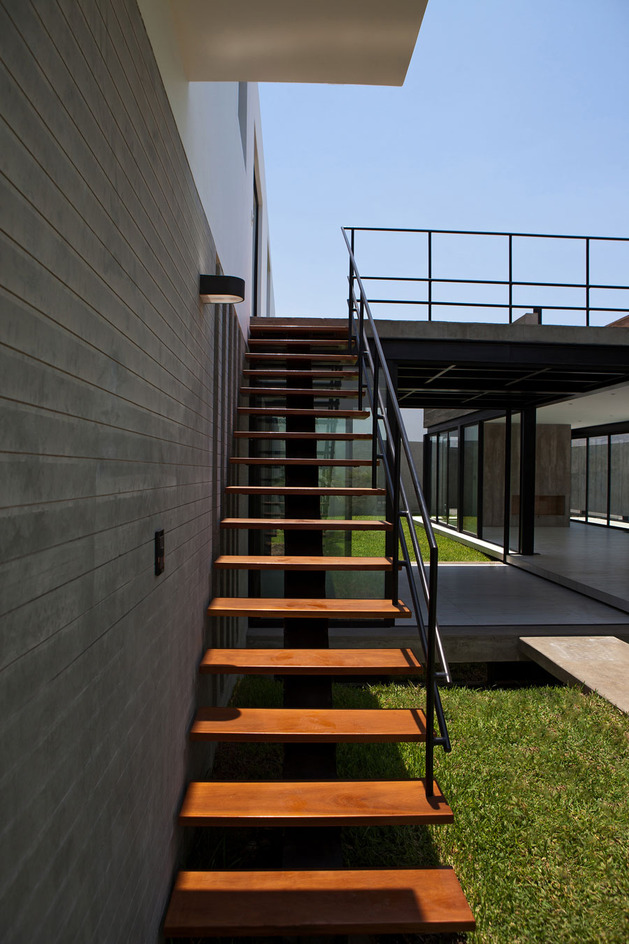 house-with-detached-glass-walled-living-area-18-side-stairs.jpg