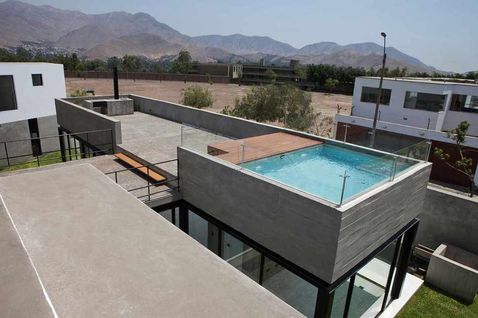 House with rooftop pool for Construire deck piscine
