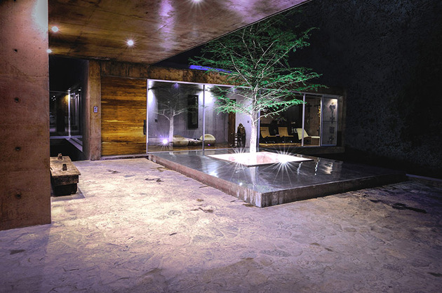 mountainside-home-made-with-aged-materials-12-courtyard-night.jpg