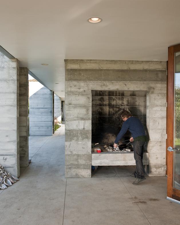 prefab-concrete-farmhouse-cypress-slab-table-salvaged-branch-crystal-chandelier-10-deck.jpg