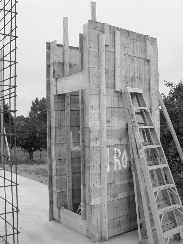 prefab-concrete-farmhouse-cypress-slab-table-salvaged-branch-crystal-chandelier-11-forms.jpg