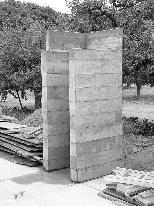 prefab-concrete-farmhouse-cypress-slab-table-salvaged-branch-crystal-chandelier-12-modules.jpg
