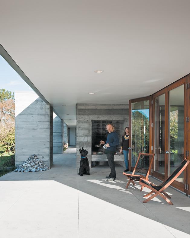 prefab-concrete-farmhouse-cypress-slab-table-salvaged-branch-crystal-chandelier-13-deck.jpg
