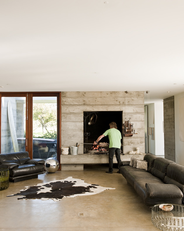 prefab-concrete-farmhouse-cypress-slab-table-salvaged-branch-crystal-chandelier-15-living.jpg