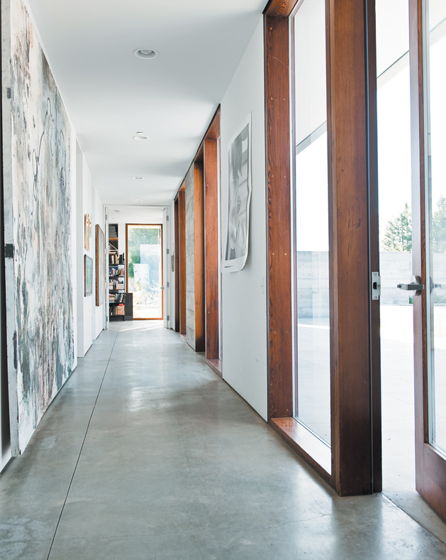 prefab-concrete-farmhouse-cypress-slab-table-salvaged-branch-crystal-chandelier-19-hall.jpg