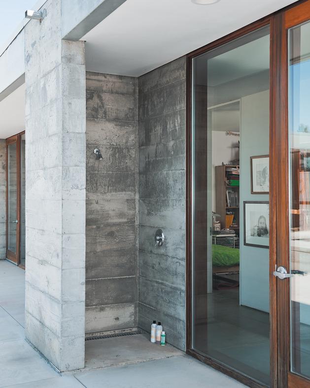 prefab-concrete-farmhouse-cypress-slab-table-salvaged-branch-crystal-chandelier-21-shower.jpg