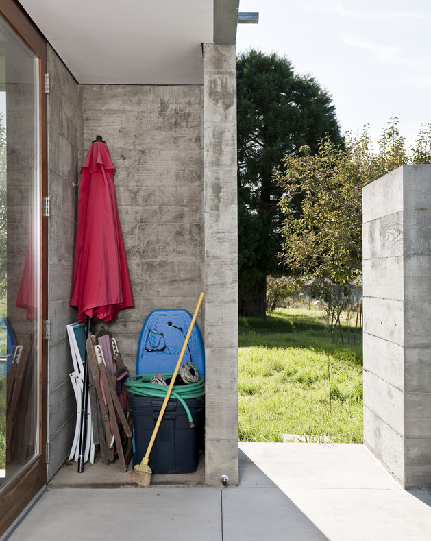 prefab-concrete-farmhouse-cypress-slab-table-salvaged-branch-crystal-chandelier-22-storage.jpg