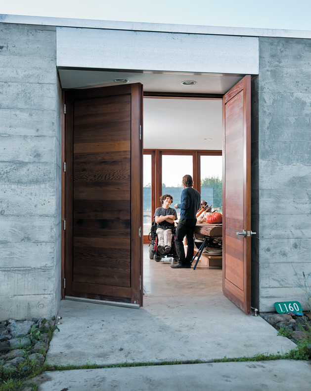 prefab-concrete-farmhouse-cypress-slab-table-salvaged-branch-crystal-chandelier-3-entry.jpg