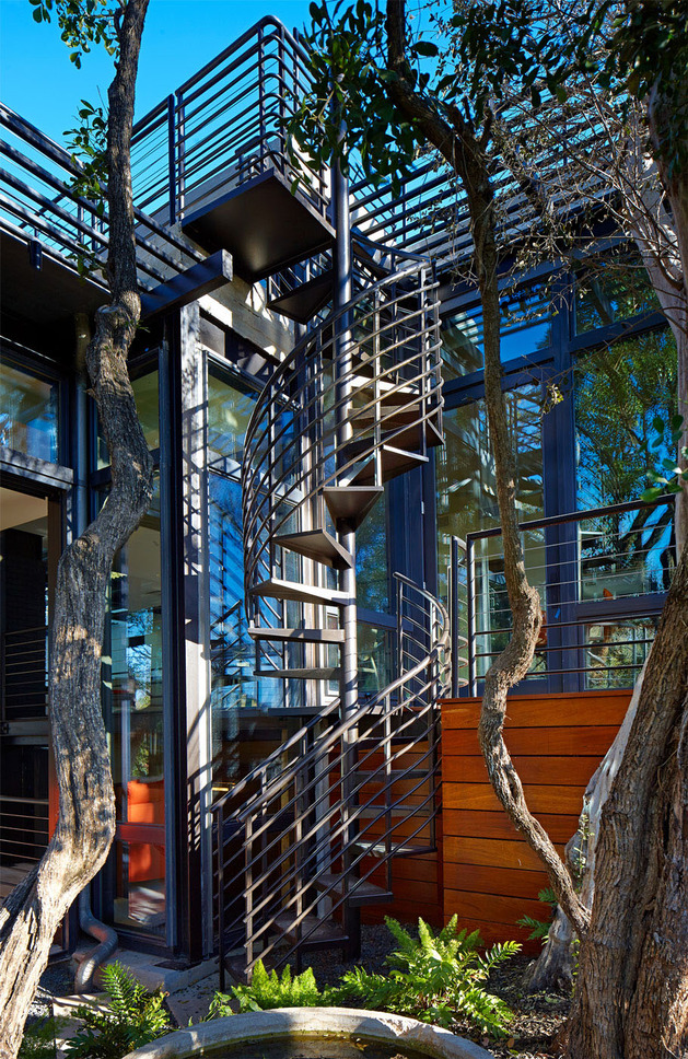 rancher-morphed-sustainable-2-storey-house-bridged-pool-11-spiral-stairs.jpg