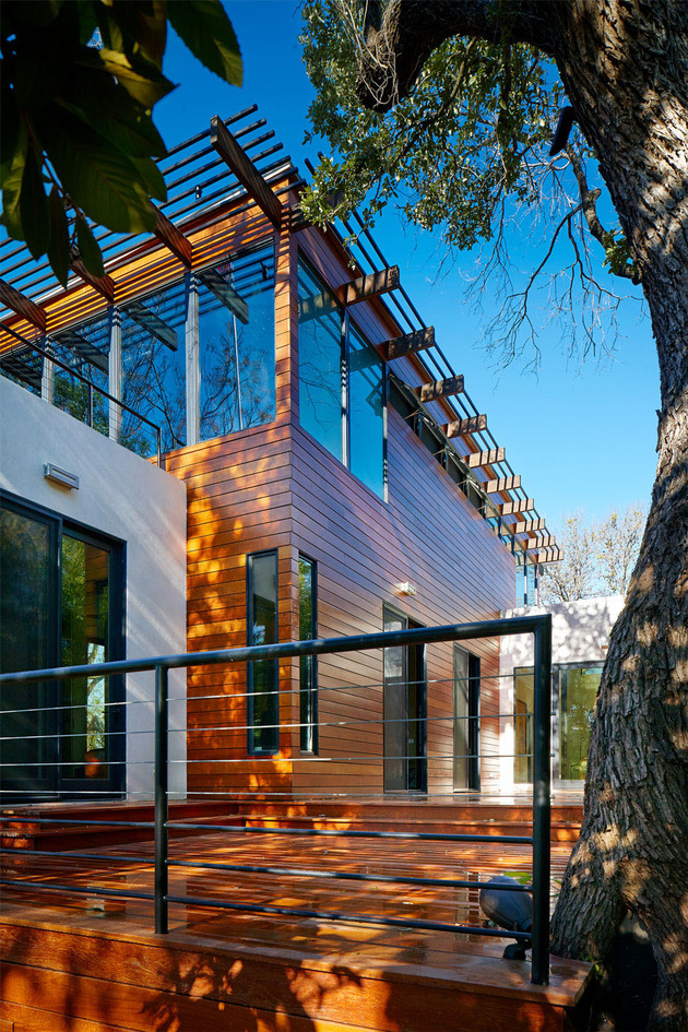 rancher-morphed-sustainable-2-storey-house-bridged-pool-31-exterior.jpg