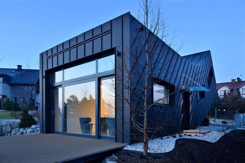 small home creates large statement with vertically curved facadeview in gallery small home large statement vertically curved facade 5