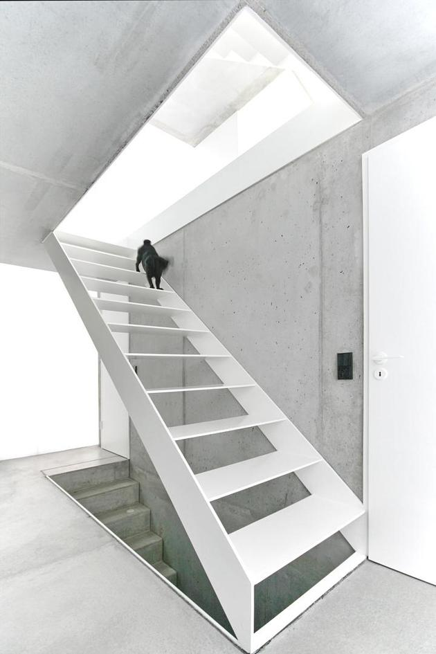 tall-minimalistic-hillside-house-built-from-concrete-13-top-stairs.jpg