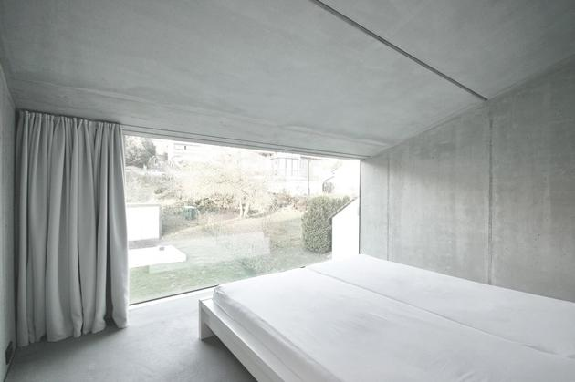 tall-minimalistic-hillside-house-built-from-concrete-14-bedroom.jpg