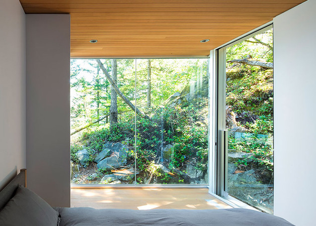 cantilevered-contemporary-escape-in-canadian-wilderness-11-second-bedroom.jpg