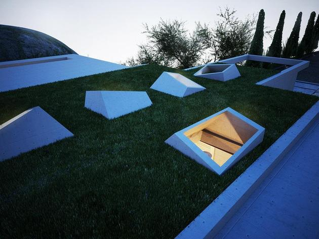 creatively-semi-buried-home-rises-earth-art-8-skylights.jpg