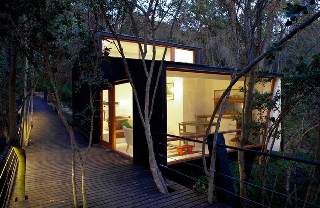 elevated walkway punctured trees forest cabin 1 ramp thumb 630xauto 43516 Forest Cabin on Stilts Accessed by Elevated Ramp