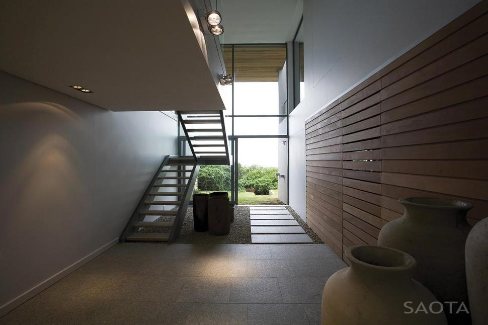 Lighting Basement Washroom Stairs: Home Embraces Indoor-Outdoor Lifestyle As It Steps Down Slope