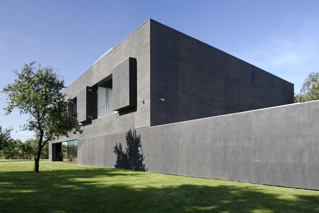 house-closes-concrete-cube-covering-glazed-areas-5-shutters.jpg