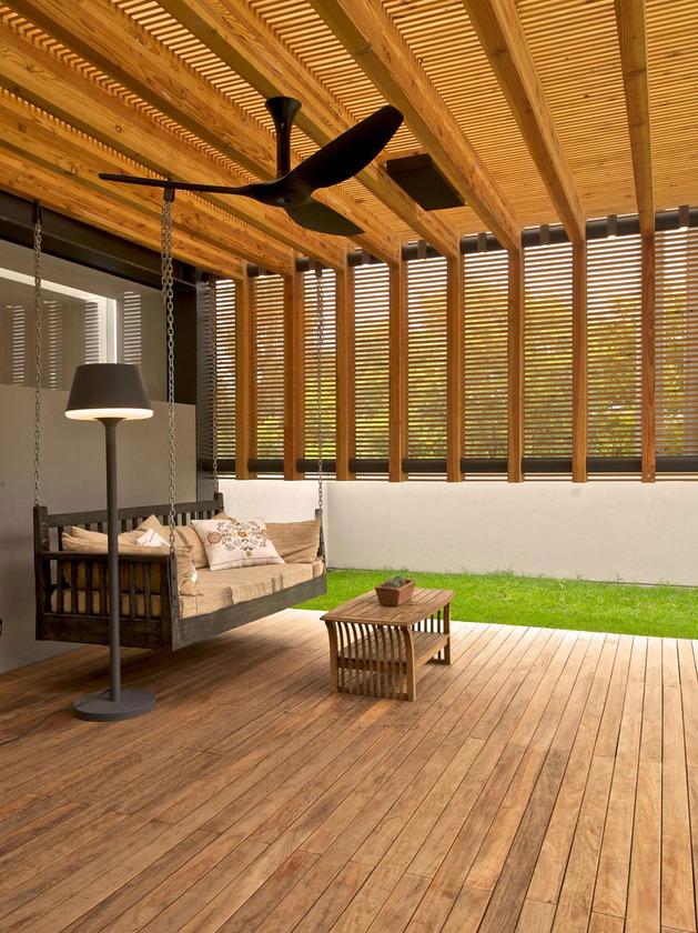 indoor-outdoor-zones-accentuated-vertical-gardens-17-porch-swing.jpg