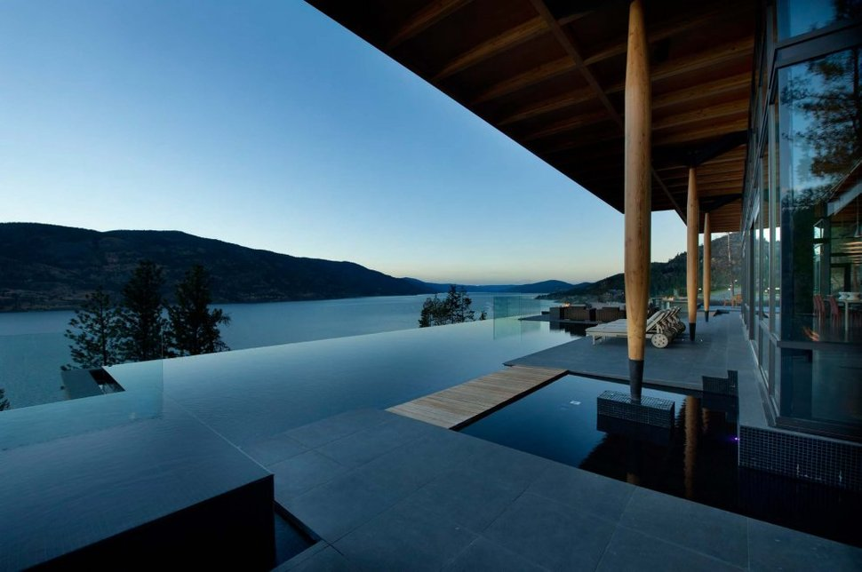 Stunning lakeside home blends infinity pool with lake and sky