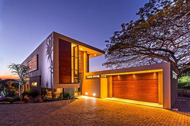 saturated-blues-pool-interiors-lush-green-landscape-4-garage.jpg