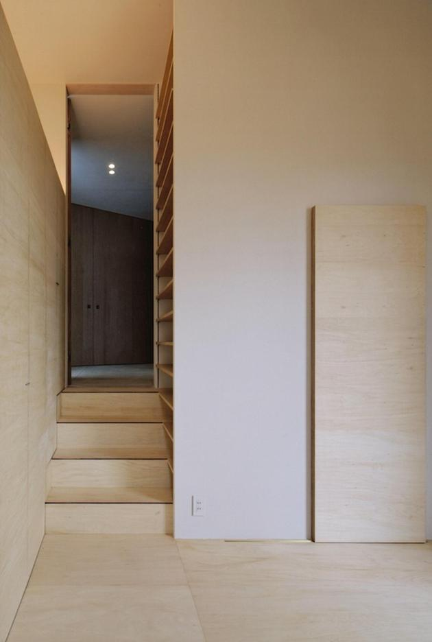 steep-slope-house-with-bookshelf-lined-interior-12-lower-level.jpg