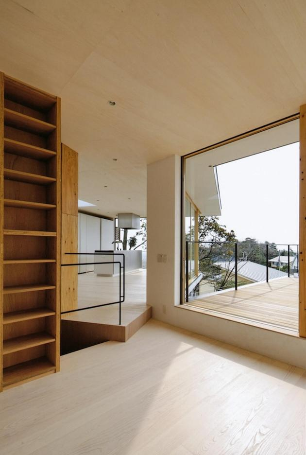 steep-slope-house-with-bookshelf-lined-interior-6-step-down.jpg