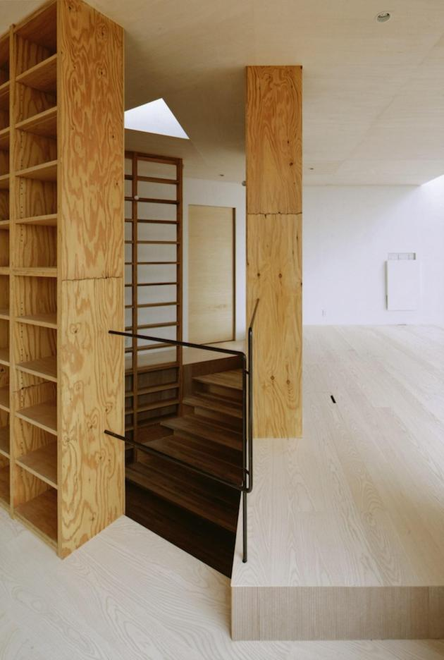 steep-slope-house-with-bookshelf-lined-interior-8-hidden-stairs.jpg