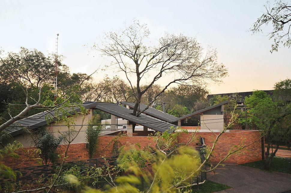 Nice Tree Pierces Roof And Other Daring Details Within Brick Home