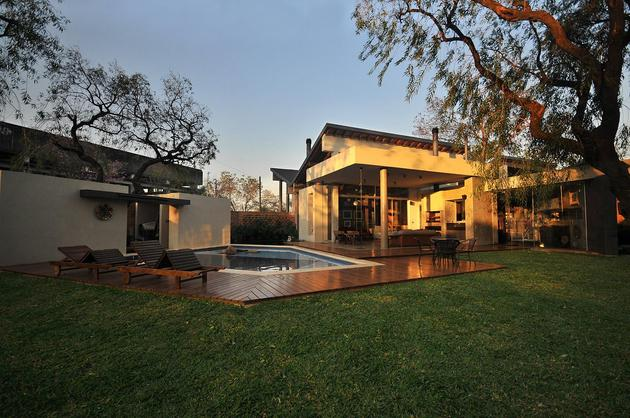 tree-pierces-roof-other-details-brick-home-13-pools.jpg