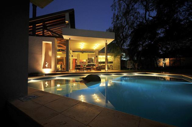 tree-pierces-roof-other-details-brick-home-15-pool.jpg