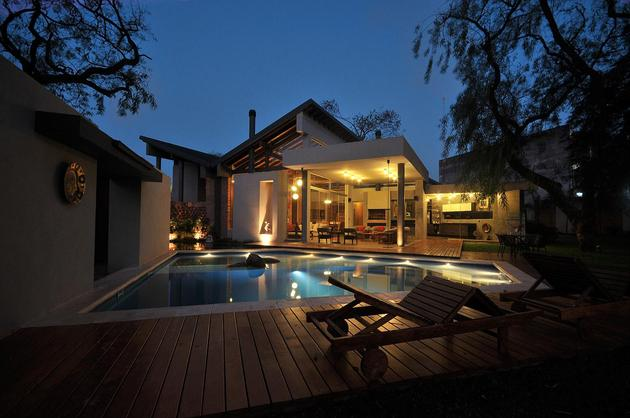 tree-pierces-roof-other-details-brick-home-16-pools.jpg