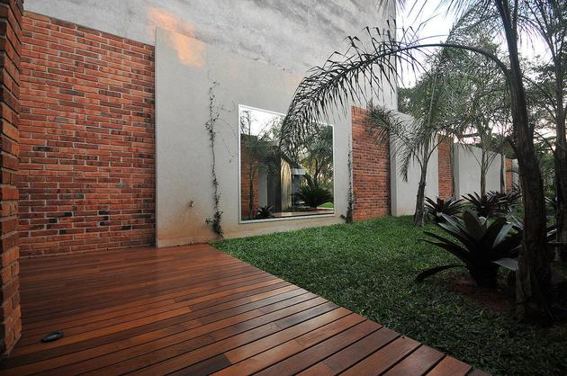 tree-pierces-roof-other-details-brick-home-24-fence.jpg