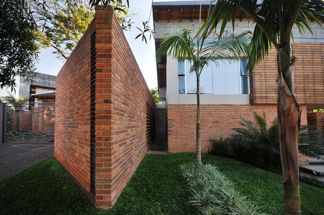 tree-pierces-roof-other-details-brick-home-3-corridor.jpg