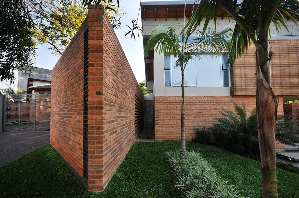 View In Gallery Tree Pierces Roof Other Details Brick Home 3