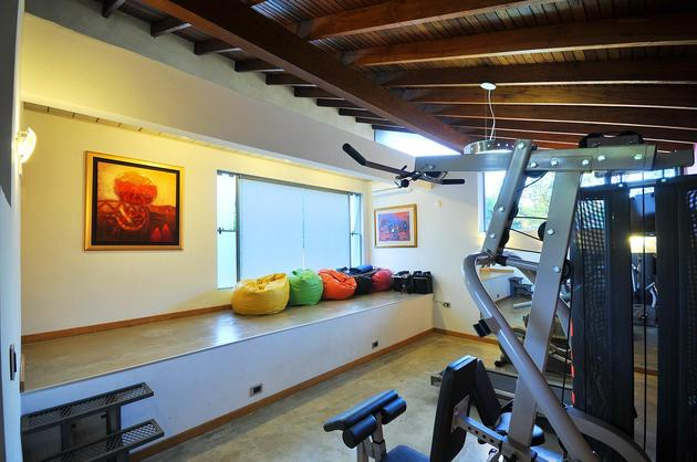 tree-pierces-roof-other-details-brick-home-35-gym.jpg