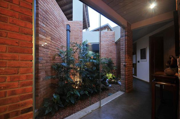tree-pierces-roof-other-details-brick-home-36-courtyard.jpg
