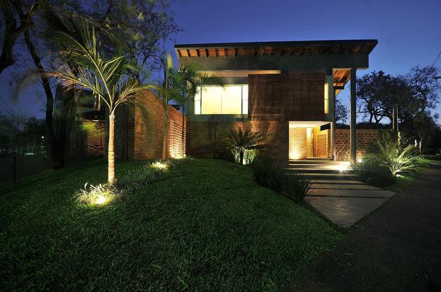 tree-pierces-roof-other-details-brick-home-8-entry.jpg