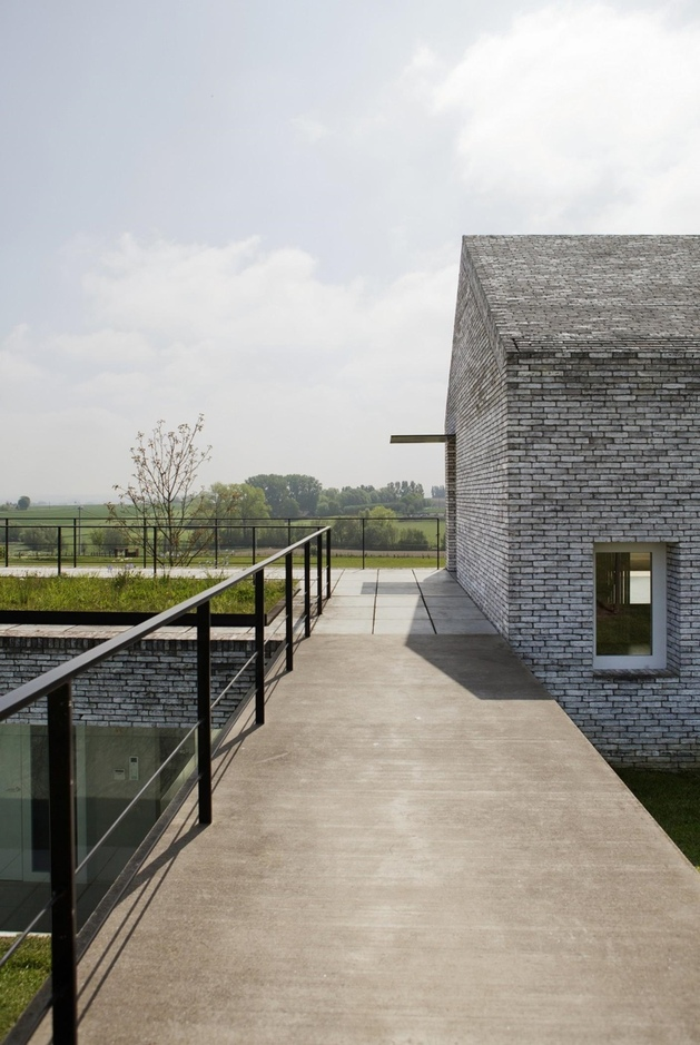 ultramodern-house-made-from-twin-traditional-structures-11-main-entry.jpg