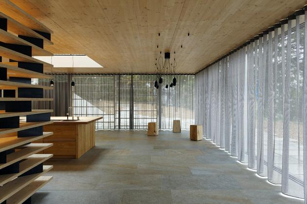 glass-living-edge-wood-clads-house-contrasts-14-dining.jpg