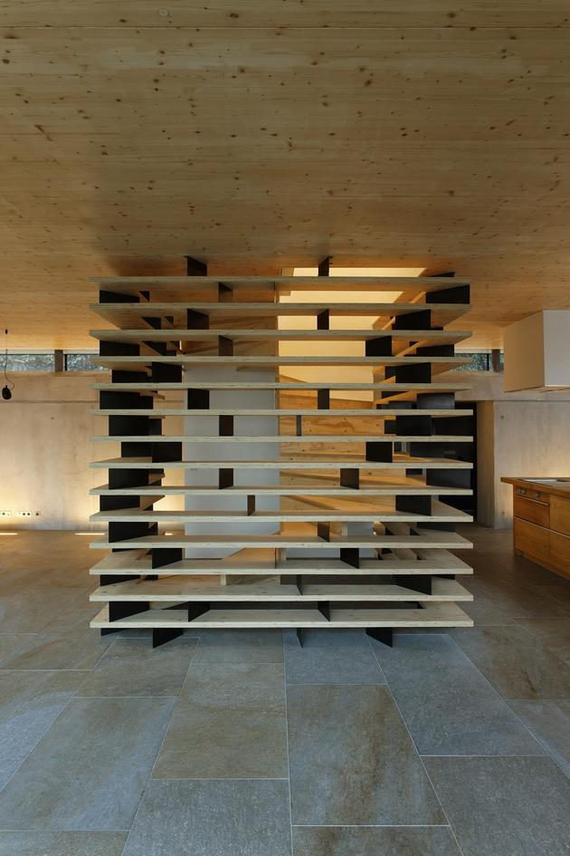 glass-living-edge-wood-clads-house-contrasts-16-stairwell.jpg