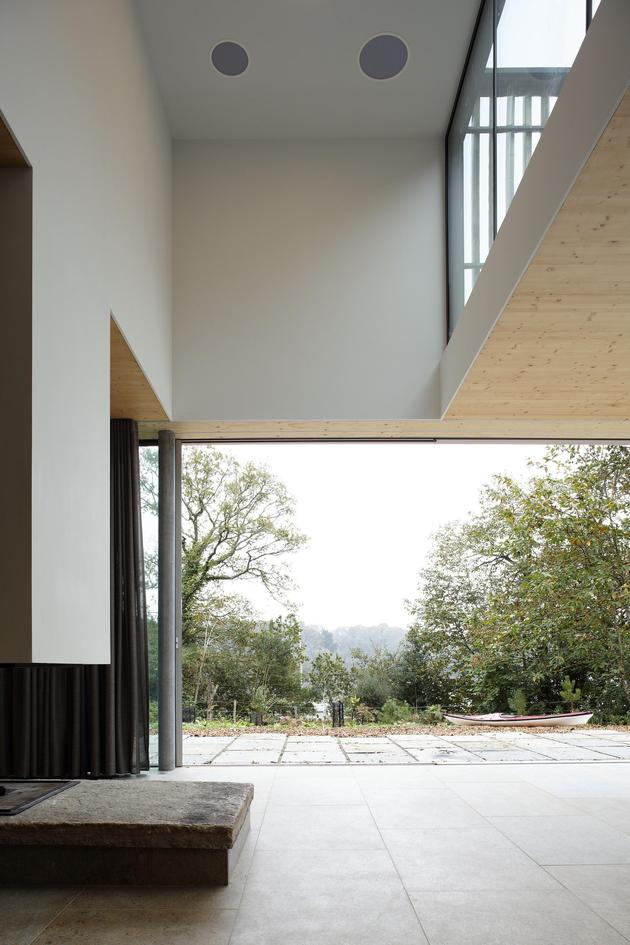 glass-living-edge-wood-clads-house-contrasts-19-living.jpg