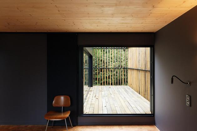 glass-living-edge-wood-clads-house-contrasts-27-bed.jpg