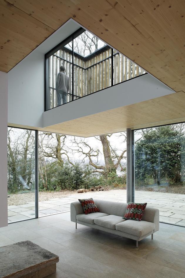glass-living-edge-wood-clads-house-contrasts-31-terrace.jpg