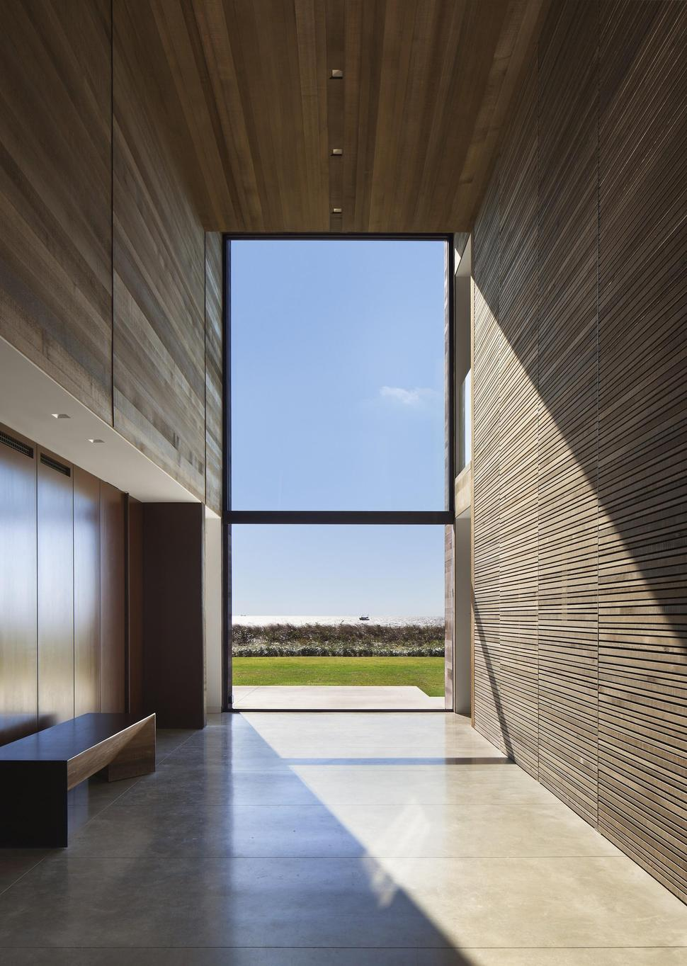 Home Sandwiched Between Pond And Ocean Maximizes Views And